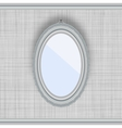 Blank oval picture frame on a gray wall with vector image