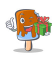 wink ice cream character cartoon with gift vector image
