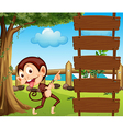 A monkey pointing at the empty signboard vector image vector image