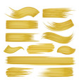 golden brushstrokes set on white vector image