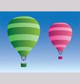 green and pink hot air balloons vector image