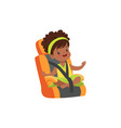 adorable african little girl sitting in orange car vector image vector image
