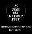 grunge vintage whiskey font old handcrafted vector image