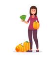 a happy smiling farm girl with pumpkin vector image vector image