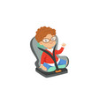 cute little boy in glasses sitting in car seat vector image