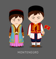 montenegrins in national dress with a flag vector image vector image