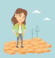 sad woman standing on cracked earth in the desert vector image vector image