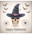 Happy Halloween card with a skull in witch hat