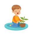 cute happy little boy sitting on the floor and vector image vector image