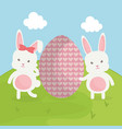 cute rabbits with easter eggs painted in the field vector image vector image
