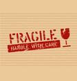 grunge fragile sign stamp on cardboard box for vector image