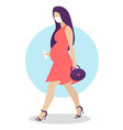 pregnant woman walking in corall dress active