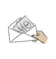 hand of businessman holding money in envelope vector image vector image
