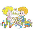 small children playing in a nursery vector image vector image