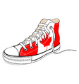 Hand draw modern sport shoes with Canada flag vector image