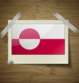 Flags Greenland at frame on wooden texture vector image