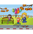 Two girls with a kid holding a balloon in the park vector image vector image
