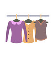 clothes hanging on hangers in women clothing store vector image vector image
