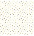 Seamless pattern of random golden dots vector image vector image