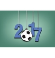 Soccer ball and 2017 hanging on strings vector image vector image