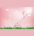 balloon flying over grass with heart float on the vector image vector image