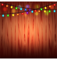 Christmas lights on wood background vector image