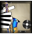 blue saxophone and piano keys in the form of vector image vector image