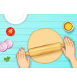 human hand rolling dough on wooden board for bread vector image vector image