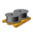Coils with a black cord are on a wooden pallet vector image vector image