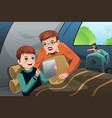 father and son reading a tablet pc in a camping vector image