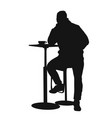 man silhouette sitting at a table in the cafe bar vector image
