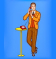 pop art man talking on a retro phone and covering