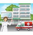 A nurse in front of the hospital vector image vector image