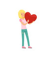 pretty blonde teen girl holding red heart happy vector image vector image