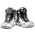 pair of dirty boots isolated on white vector image