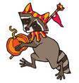 raccoon in jester costume carries a pumpkin vector image vector image