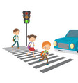 children cross road to a green traffic light vector image vector image