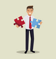 businessman holds two pieces of the puzzle in his vector image