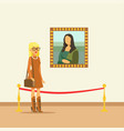 young woman looking at the painting hanging on vector image vector image