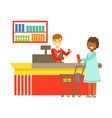 cashier serving buyer at the cash register in vector image
