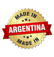 made in Argentina gold badge with red ribbon vector image vector image