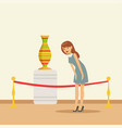 young woman viewing antique vase at the museum vector image vector image
