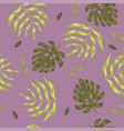 seamless pattern with tropical leaves on a purple vector image