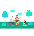people in park playing guitar bonfire vector image vector image