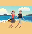 Senior couple walking on beach