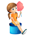 A young woman eating a cotton candy vector image vector image