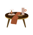 round wooden small coffee table with candle vector image vector image