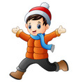 cartoon boy wearing winter clothes vector image vector image