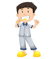 Boy in striped pajamas brushing teeth vector image