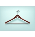 Clothes Wooden Hanger with Metal Tag on Background vector image vector image